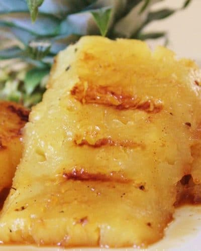 Slices of Grilled Pineapple on a plate.