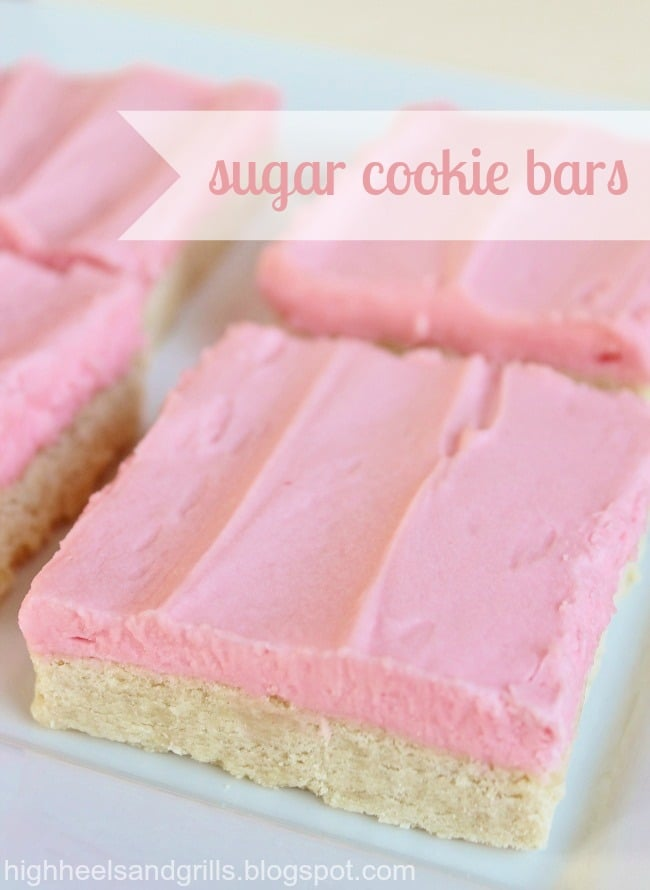 Up close photo of a plate of sugar cookie bars with pink frosting.