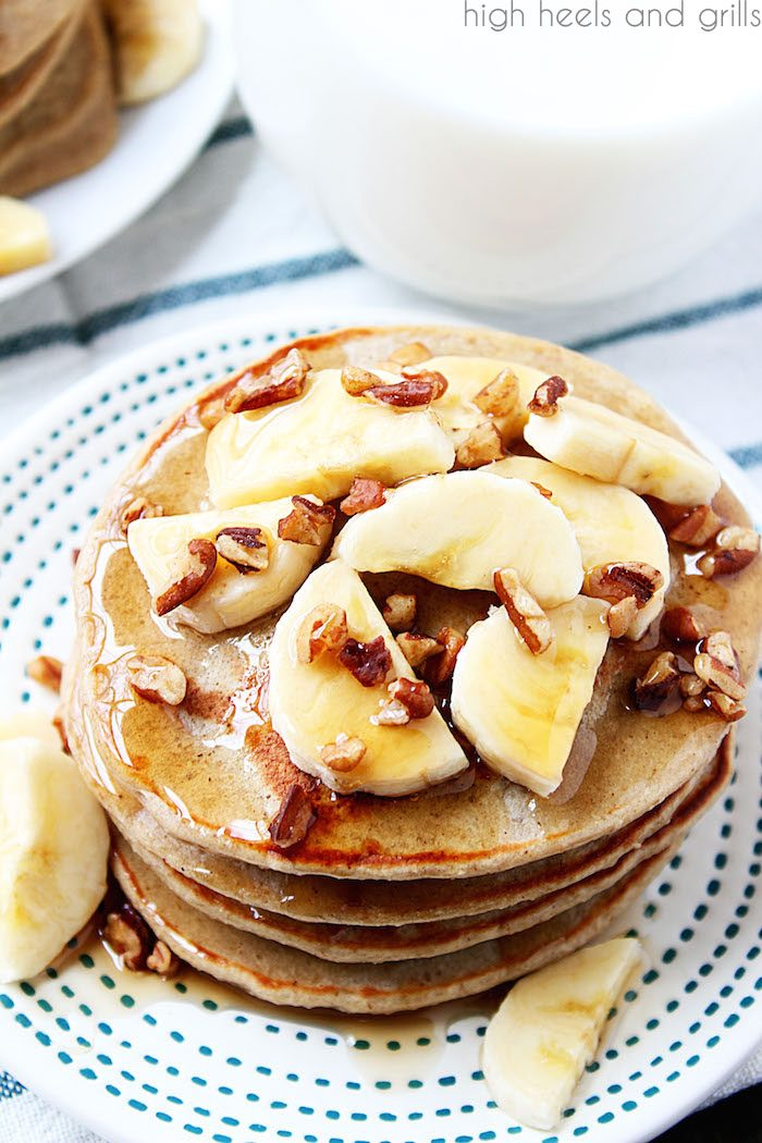 Healthy Banana Pancakes - top view of stack with bananas and pecans on top.