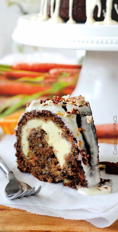 A piece of cake on a plate, with Cream and Carrot