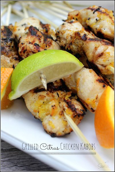 Lemon wedges on top of grilled chicken kabobs.