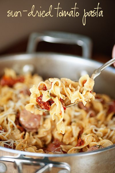 A close up of pasta in a bowl, with Chicken and Sausage