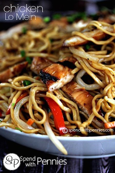 A close up picture of chicken lo mein in a white dish.