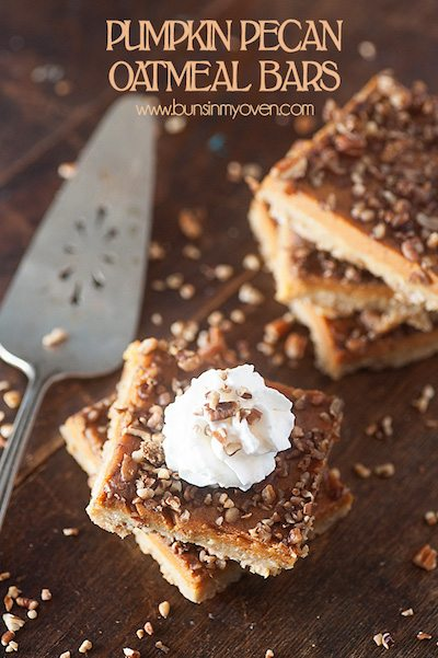 A few squares of pumpkin pecan oatmeal bars on a wooden table.