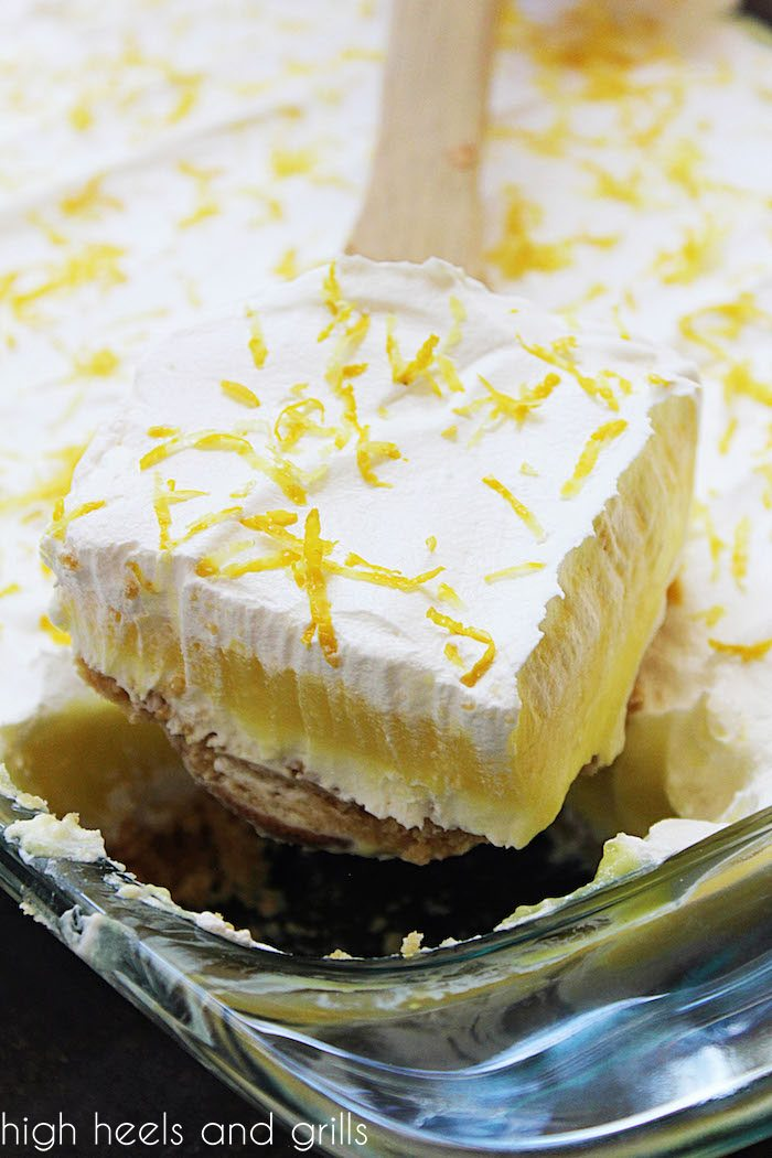 No Bake Lemon Layered Dessert being scooped out of pan.