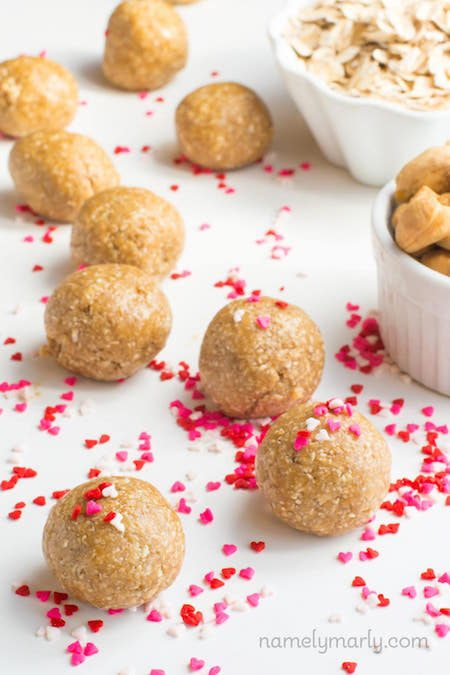 Batch of Skinny No Bake Sugar Cookie Energy Bites with heart shaped sprinkles