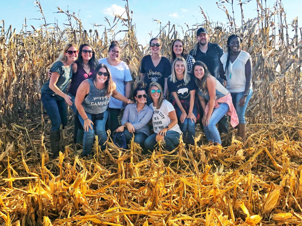 Food bloggers in a field of corn in Iowa