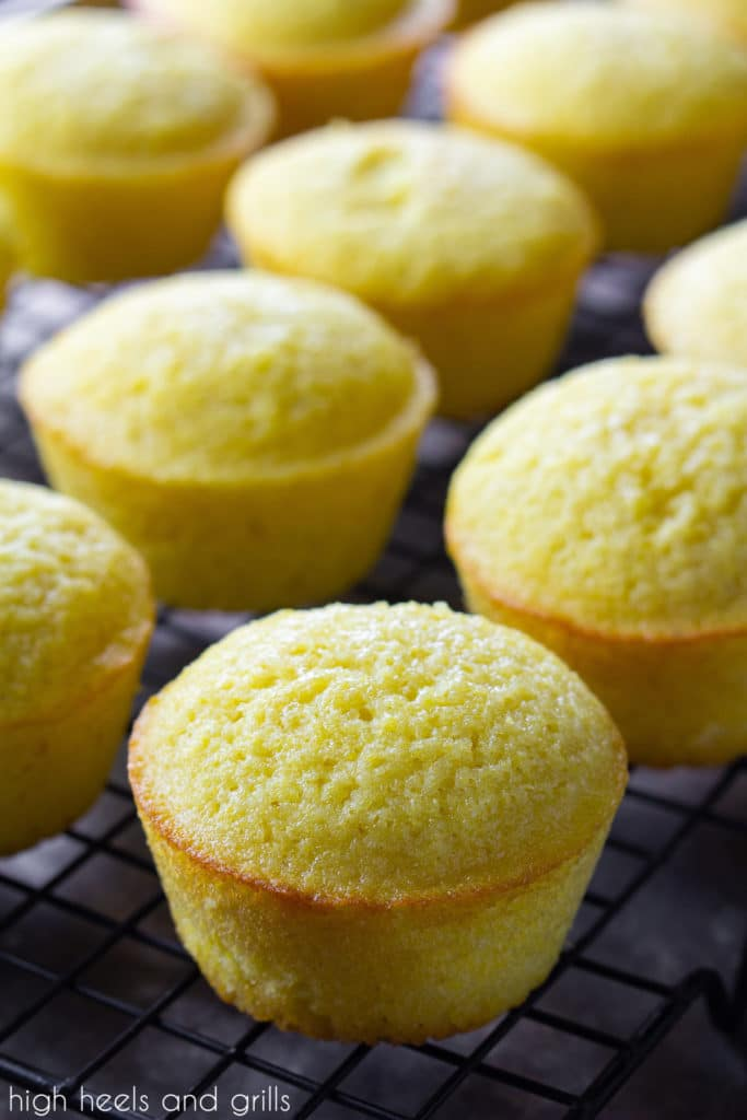 Sweet cornbread muffins cooling on a cooling rack.